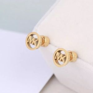 Michael Kors Gold Tone Logo Cut Off Stud Earrings